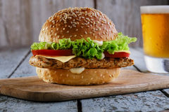 Burger with grilled chicken. And beer Royalty Free Stock Image