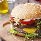 Burger, hamburger with frech fries, ketchup, mustard and fresh vegetables Royalty Free Stock Photography