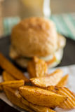 Burger and hand cut fries on a plate. Stock Photo