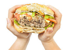Burger in hands Stock Photo