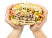 Burger in hands Stock Photo