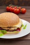 Burger of homemade close up on wooden background. Top view. - Royalty Free Stock Photos