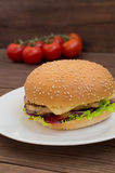 Burger of homemade close up on wooden background. Top view. - Royalty Free Stock Photo
