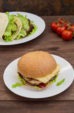 Burger of homemade close up on wooden background. Top view. - Stock Image