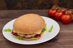 Burger of homemade close up on wooden background. Top view. - Royalty Free Stock Images