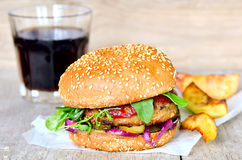 Burger with homemade fries Royalty Free Stock Images