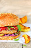 Burger with homemade fries Royalty Free Stock Photos