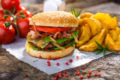 Burger. Homemade burger on wooden background Stock Images