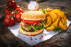 Burger. Homemade burger on wooden background Royalty Free Stock Image