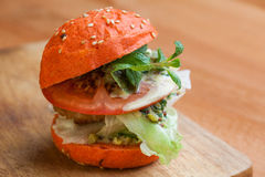 Burger. Homemade burger on wooden background Stock Photography