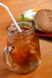 Burger and iced tea Royalty Free Stock Image