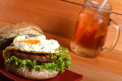 Burger and iced tea Royalty Free Stock Photography