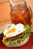 Burger and iced tea Stock Photos