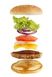 Burger ingredients. Exploded view of burger, isolated on white Stock Photography