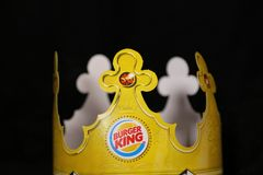 Burger King- a commercial restaurant famous burger place for kid events!. Burger King hats are famous on birthdays for kid events! The Burger King is a famous stock image