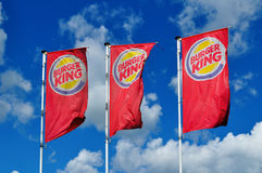 Burger King Restaurants waving advertising flags against blue sky Royalty Free Stock Photo