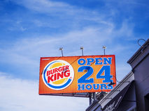 Burger King sign on blue sky background Stock Images