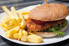 Burger made of fried turkey with french-fried potato Royalty Free Stock Photos