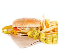 Burger with measure tape Royalty Free Stock Photography