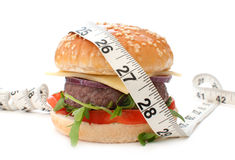 Burger with measuring tape Royalty Free Stock Image