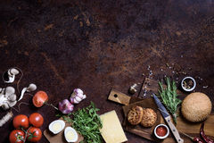 Burger with meat, cheese and fresh vegetables. On a wooden board. Top view, copy space. Royalty Free Stock Photography
