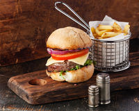Burger with meat and French fries Royalty Free Stock Photos