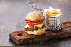 Burger with meat and French fries Stock Photos