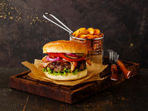 Burger with meat and potato wedges Stock Photography