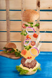 Burger in motion Royalty Free Stock Photo