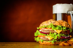 Burger and Mug of Cold Beer with Copy Space Stock Photos