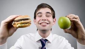 Burger oder Apfel Stockfotografie