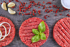 Burger patties. Fresh Burger patties on a wooden cutting board Stock Photo