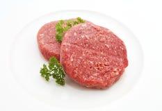 Burger patty. Fresh burger patty isolated on white Royalty Free Stock Photos