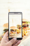 Burger photographing Royalty Free Stock Images