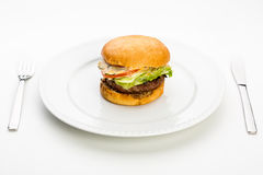 Burger on plate Royalty Free Stock Photography