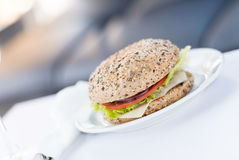 Burger on plate at restaurant Royalty Free Stock Photo