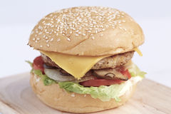 Burger pork. Burger with pork on cutting board Stock Images
