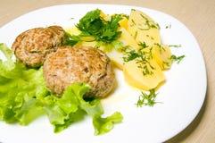 Burger and potato Stock Photography