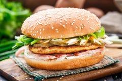 Burger with potato pancake and bacon Royalty Free Stock Photos