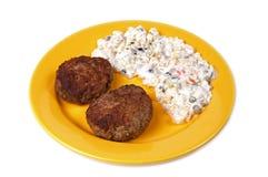 Burger and potato salad Stock Image