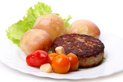 Burger with potatoes and tomatoes Stock Image