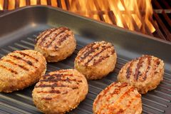 Burger put on the grill pan XXXL Stock Photos