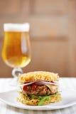 Burger with ramen and sri racha royalty free stock photography