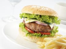 Burger with restaurant setting Royalty Free Stock Image