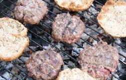 Burger roasted with bun. On hot grill Stock Photos