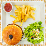 Burger with salad and  chips Stock Photo