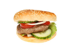 Burger. With salad in a sesame seeded bun isolated against white Royalty Free Stock Photos