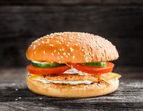 Burger with salmon patty and vegetables Stock Photography
