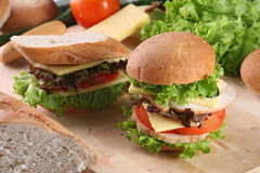 Burger and sandwich. In front of ingredients stock image