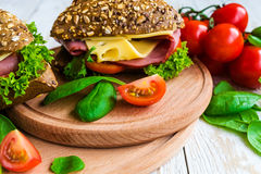 Burger sandwich with ham, cheese, tomatoes and lettuce Stock Photo